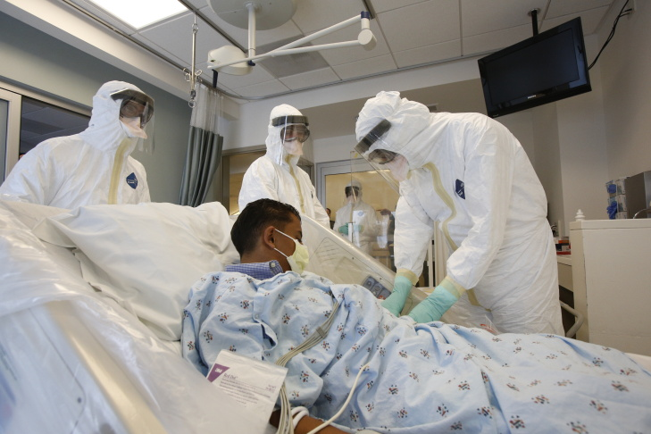UCLA health workers attend to a mock patient during an Ebola response exercise on Friday, Oct. 17, at the Ronald Reagan UCLA Medical Center.