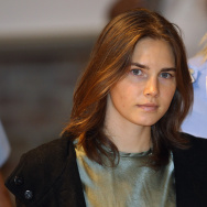 Amanda Knox is escorted to her appeal hearing at Perugia's Court of Appeal on September 29, 2011 in Perugia, Italy.