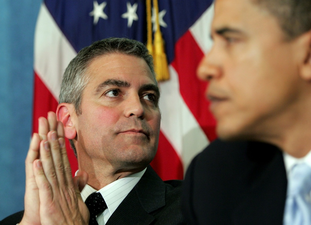 Actor George Clooney (L) and then-Senator Barack Obama (R) during the National Press Club Newsmaker's Program in Washington, DC., 2006. The two will meet again at Clooney's Studio City home for a dinner fundraiser Thursday night.