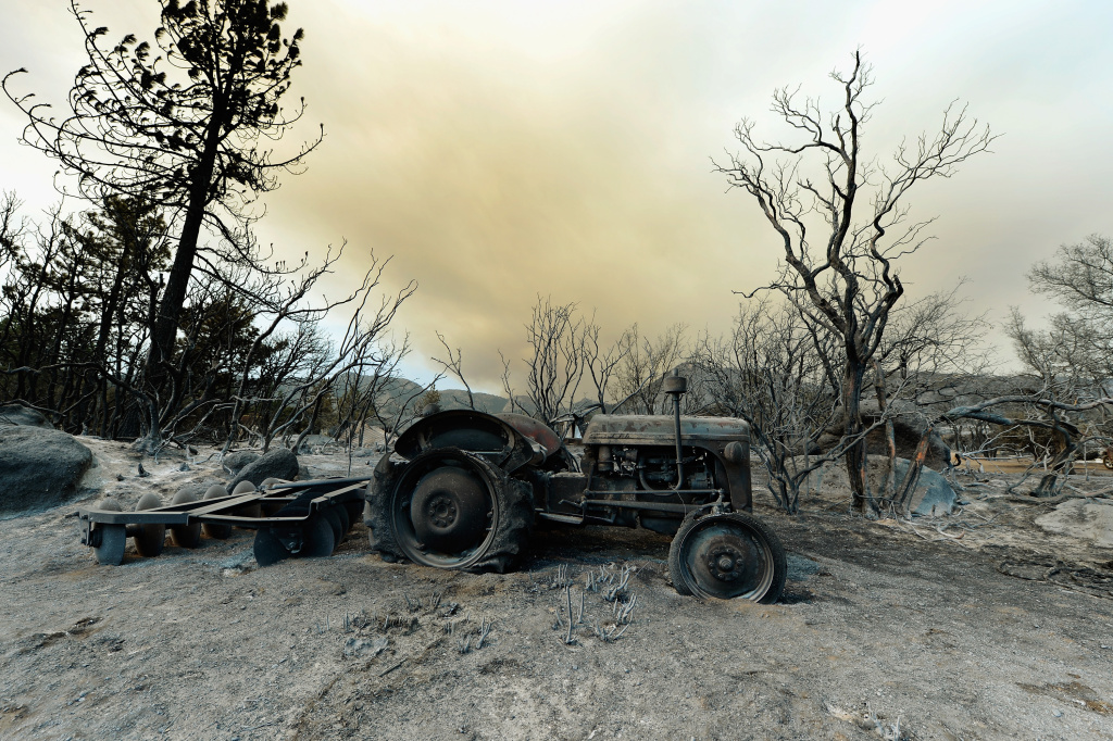 A farming tractor is left in the wake of the Mountian Fire after it scorched the area on July 18, 2013 near Idyllwild, California. The massive wildfire in Riverside county ultimately consumed 27,531 acres and cost an estimated $25.8 in damages.