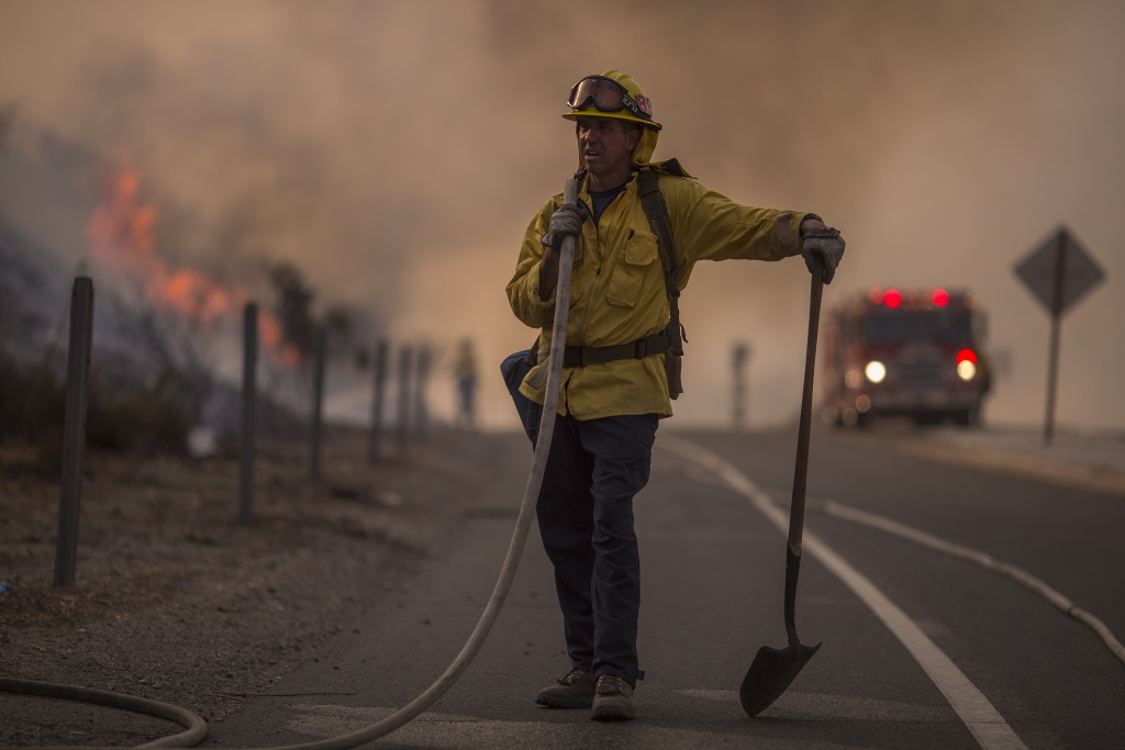 A firefighter stands on the 210 freeway during the La Tuna Fire on September 2, 2017 near Burbank.