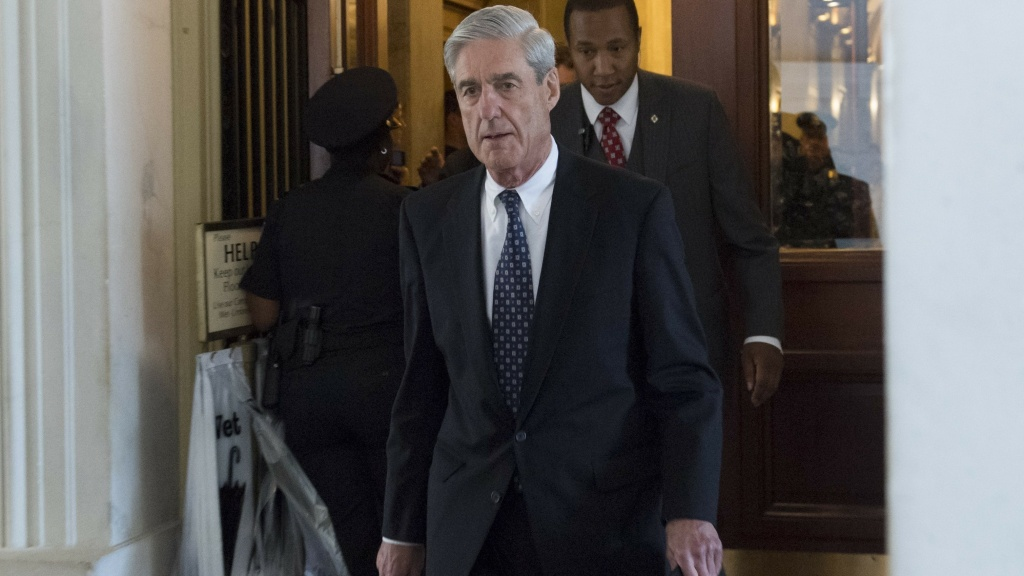 Former FBI Director Robert Mueller, special counsel leading the DOJ Russia investigation, leaves the Capitol following a meeting with the Senate Judiciary Committee in this June 21, 2017 file photo. Mueller's team has filed a new charge connected to the investigation.