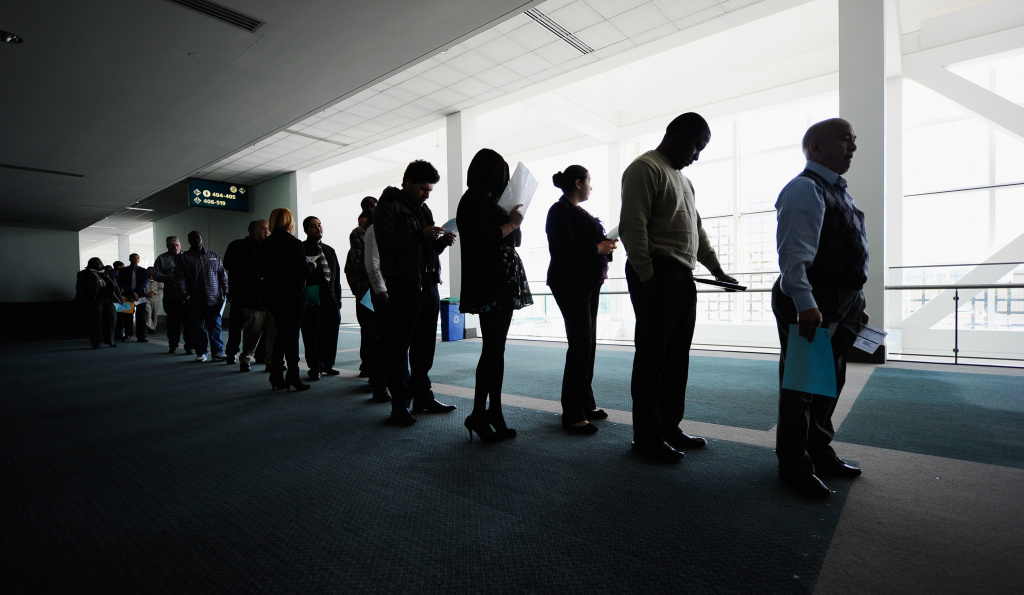 Job seekers line up to enter Choice Career Fair at the Los Angeles Convention Center on December 1, 2010 in Los Angeles, California.