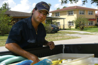 Yoelvis Bengochea cleans pools for for his family business until he can land a job as an air traffic controller.