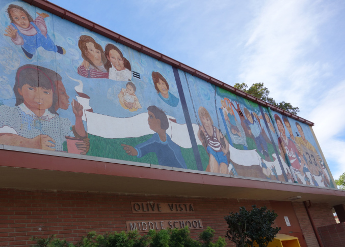 This mural decorates the street-facing wall of Olive Vista Middle School's multipurpose room, also known as Mile's Hall. The building is built of tilt-up concrete slabs, placing it among the most earthquake vulnerable buildings in the LAUSD's 13,000 inventory.
