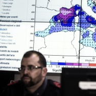 Personnel at work in the operations room of the Italian Coast Guard in Rome, Italy on Sunday during the coordination of relief efforts after a ship carrying hundreds of migrants capsizes off Libyan coast occurred in the Strait of Sicily.