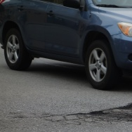 A pothole in the intersection at 8th Street and Bixel Ave. threatens drivers wheels as they cross to get onto the 110 Freeway.