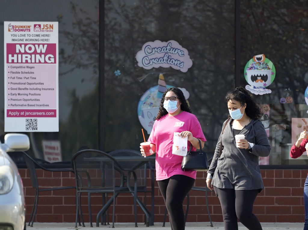 People wear face masks as they leave a store in Vernon Hills, Ill., last week. State health officials say the number of coronavirus cases and COVID-19 deaths in the state are hitting worrisome new highs.