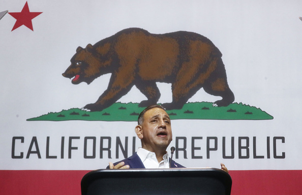 Democratic congressional candidate Gil Cisneros (CA-39) speaks at a 2018 mid-term elections rally on October 4, 2018 in Fullerton, California.