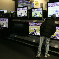 A Best Buy customer looks at a display of flat panel televisions at a Best Buy store February 1, 2007 in San Francisco.