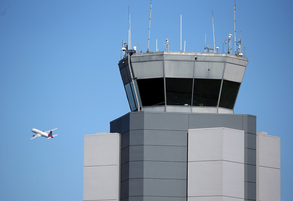A plane takes off past the control tower at San Francisco International Airport on February 25, 2013 in San Francisco, California.