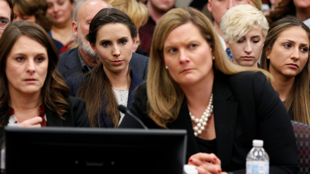 The entire USA Gymnastics board will resign, the group says. Rachael Denhollander, center, listens as Larry Nassar, a former team USA Gymnastics doctor, was sentenced to up to 175 years in prison for sexual abuse over decades of his involvement with the program.