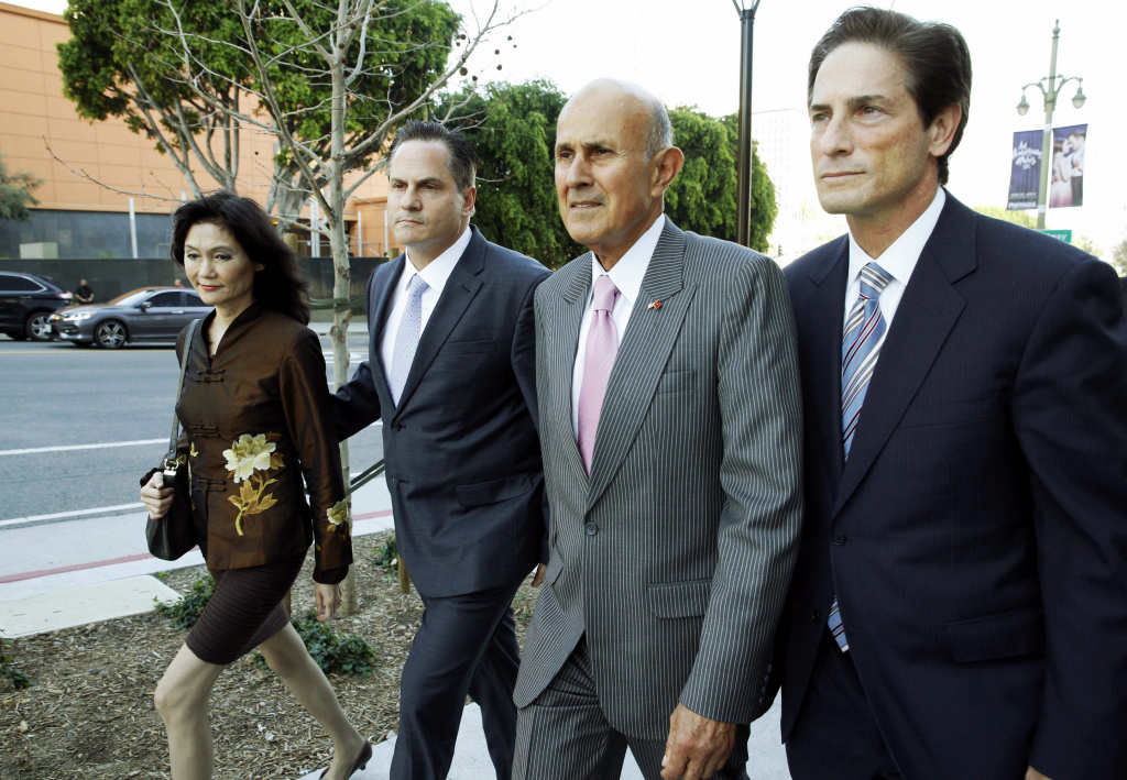Former Los Angeles County Sheriff Lee Baca, second from right, leaves federal court in Los Angeles with attorneys Nathan Hochman, right, David Hochman and Baca's wife Carol after his corruption trial went to the jury Monday, March 13, 2017, in Los Angeles. Prosecution and defense attorneys finished closing remarks earlier Monday. (AP Photo/Nick Ut)