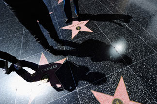 Shadows of tourist are cast on the Hollywood Walk of Fame on September 27, 2010 in Los Angeles, California. The heat wave continues to bring hot temperatures to the Southland.