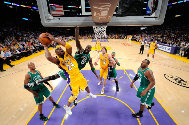 Kobe Bryant #24 of the Los Angeles Lakers puts a shot up under pressure from Kevin Garnett #5 of the Boston Celtics in Game Six of the 2010 NBA Finals at Staples Center on June 15, 2010 in Los Angeles, California.