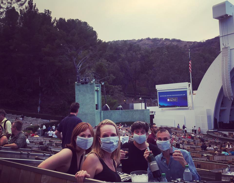 Concertgoers at the Hollywood Bowl wear face masks amid the smoke of the Sand Fire.