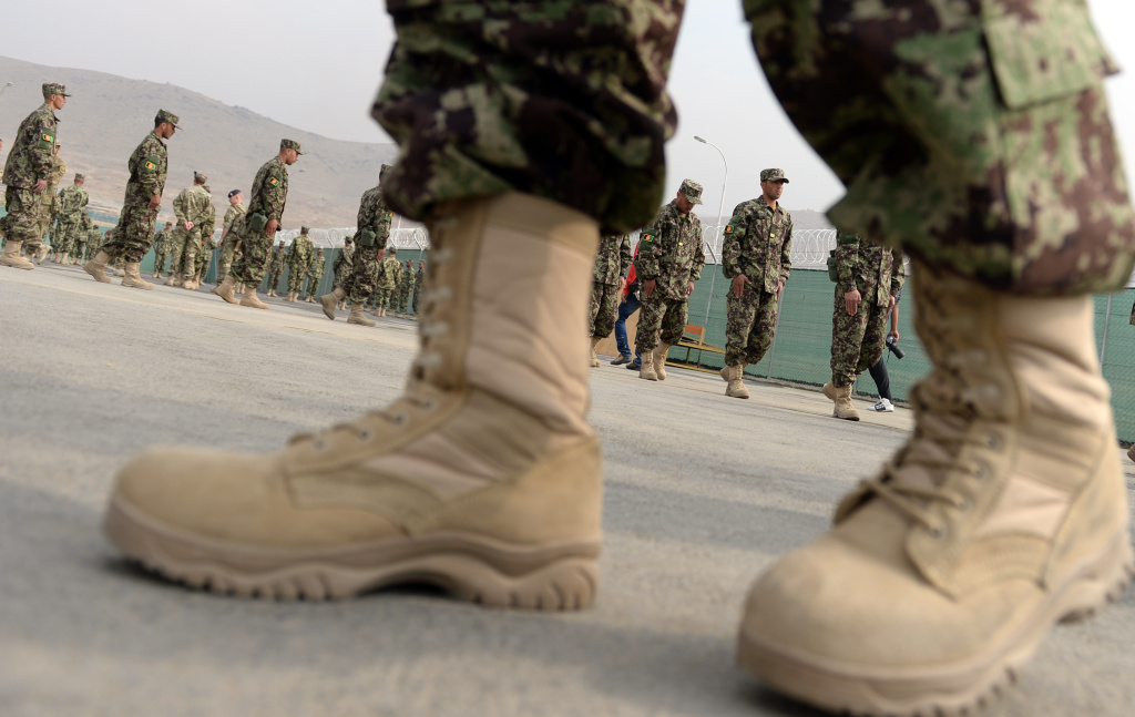Recruits performs drills at the Afghanistan National Army Officers' Academy (ANAOA) in Qargha district of Kabul on October 23, 2013.