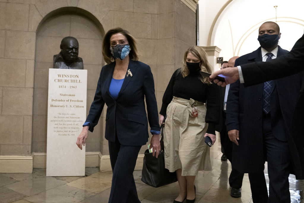 Speaker of the House Nancy Pelosi (D-CA) (L) wears a protective mask while arriving to the U.S. Capitol on January 12, 2021 in Washington, DC.