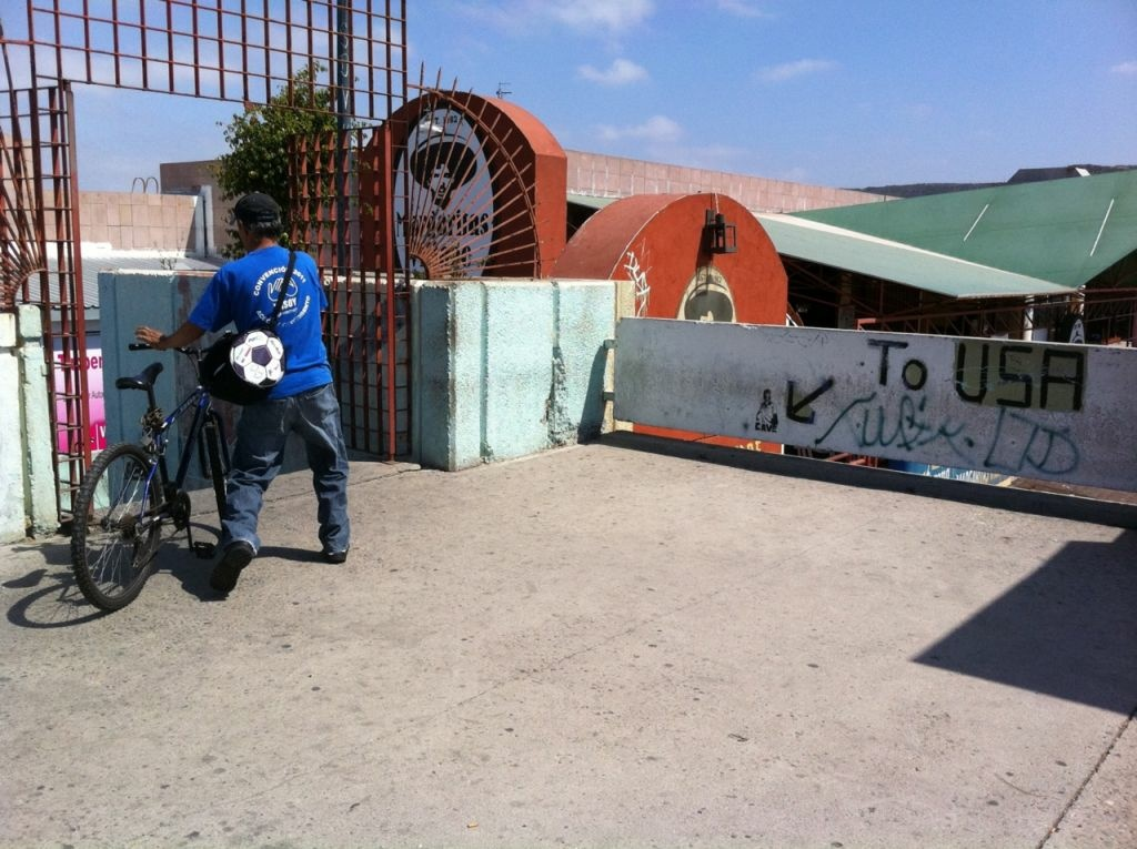 A teenager getting ready to cross from Tijuana to San Ysidro with his bike.