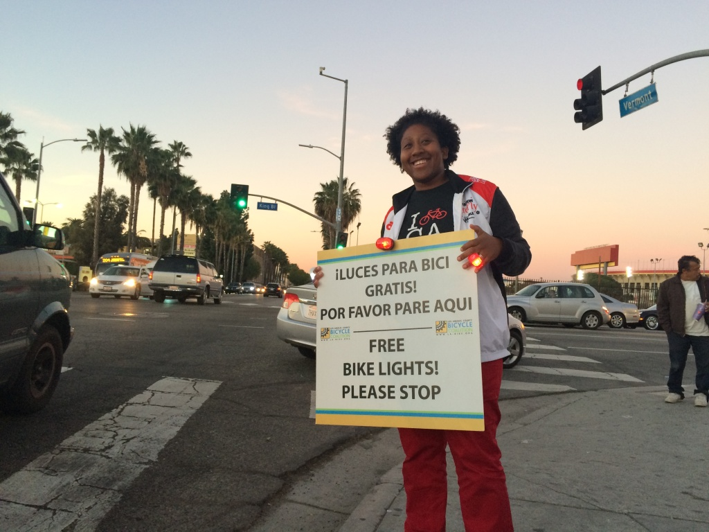 Tamika Butler, executive director of the LA County Bike Coalition, at a corner in South LA. The Coalition hands out free lights to cyclists through its program Operation Firefly.