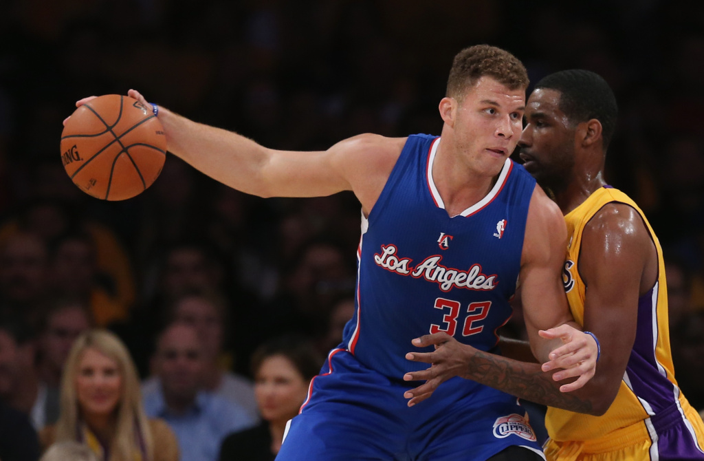 File: Blake Griffin #32 of the Los Angeles Clippers is defended by Shawne Williams #3 of the Los Angeles Lakers at Staples Center on Oct. 29, 2013 in Los Angeles.