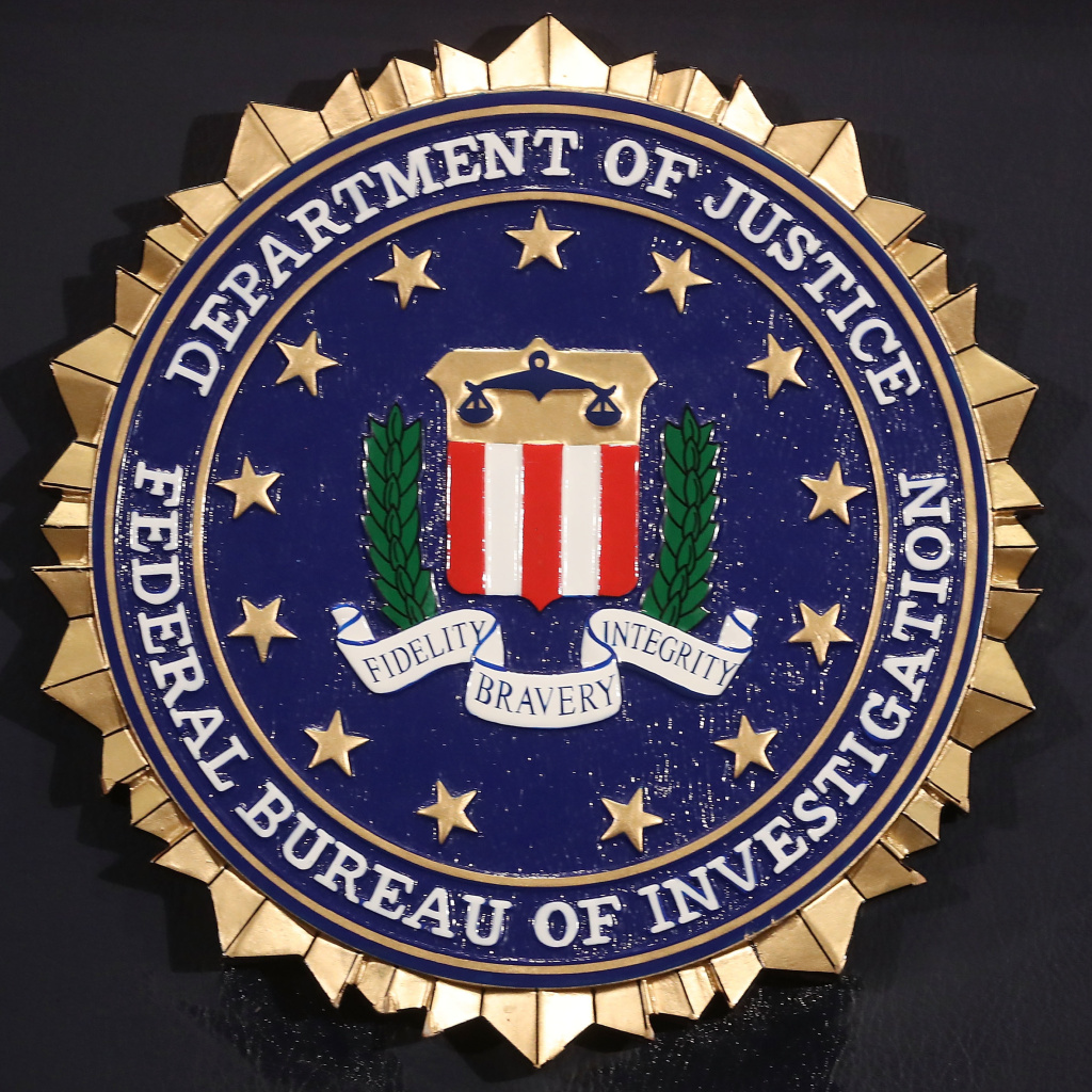 The FBI seal is attached to a podium prior to Director is Christopher A. Wray speaking at a news conference at FBI Headquarters, on June 14, 2018 in Washington, D.C. after the release of an inspector general's report.