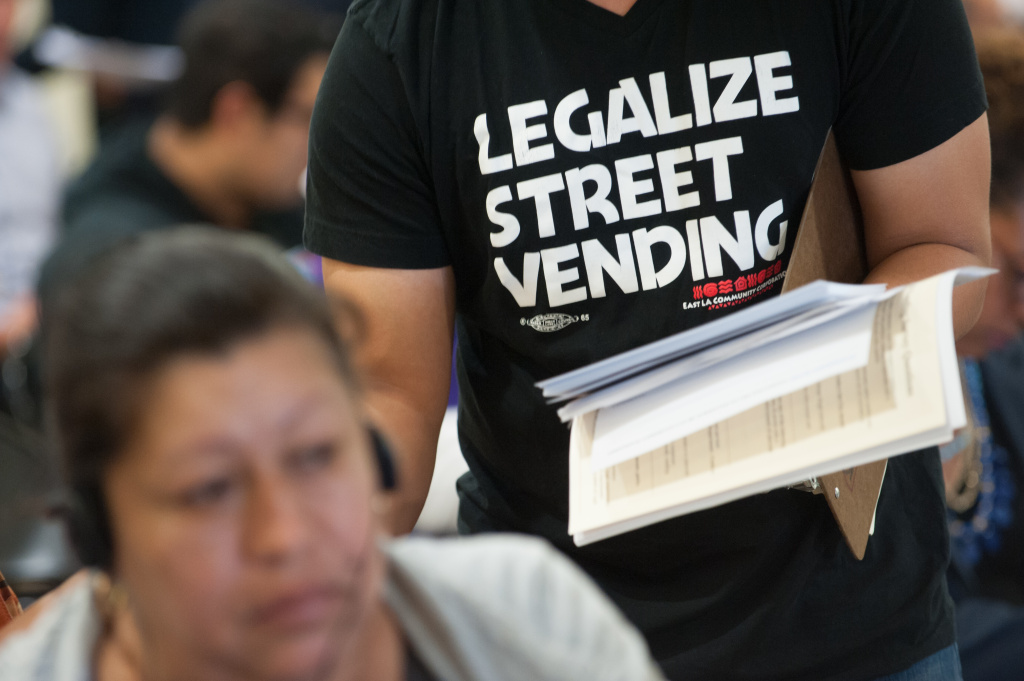 File: In a unanimous vote Wednesday, the Los Angeles City Council moved to decriminalize street vending, changing the penalty for vending from a misdemeanor to a citation.