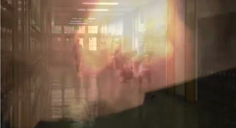 Fireballs fade into school hallways in this screenshot from