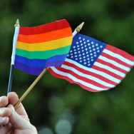 A gay man holds the gay and lesbian flag