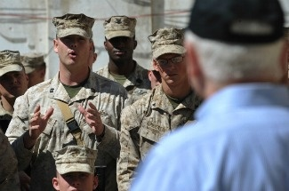US Defense Secretary Robert Gates takes questions from US Marines while visiting the 3rd Battalion, 5th Marine Regiment at Forward Operating Base Sabit Qadam on March 8, 2011 in Afghanistan's Helmand province.