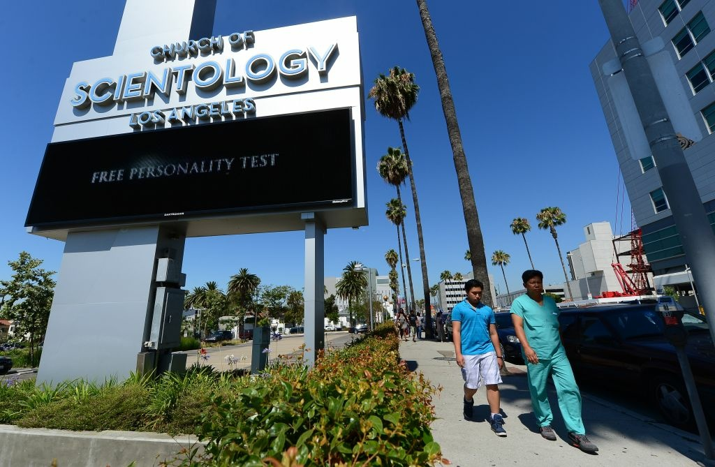 Pedestrians walk past the Church of Scientology in Los Angeles, Calif.