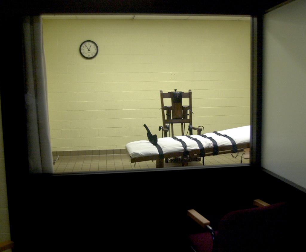 A view of the death chamber from the witness room at the Southern Ohio Correctional Facility shows an electric chair and gurney August 29, 2001 in Lucasville, Ohio. Is there a humane way to execute criminals?