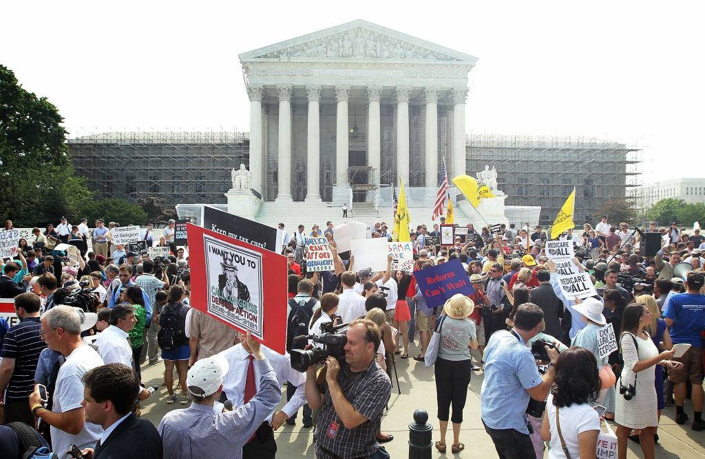Supporters and protesters gather in front of the U.S. Supreme Court to find out the ruling on the Affordable Health Act June 28, 2012 in front of the U.S. Supreme Court in Washington, DC.