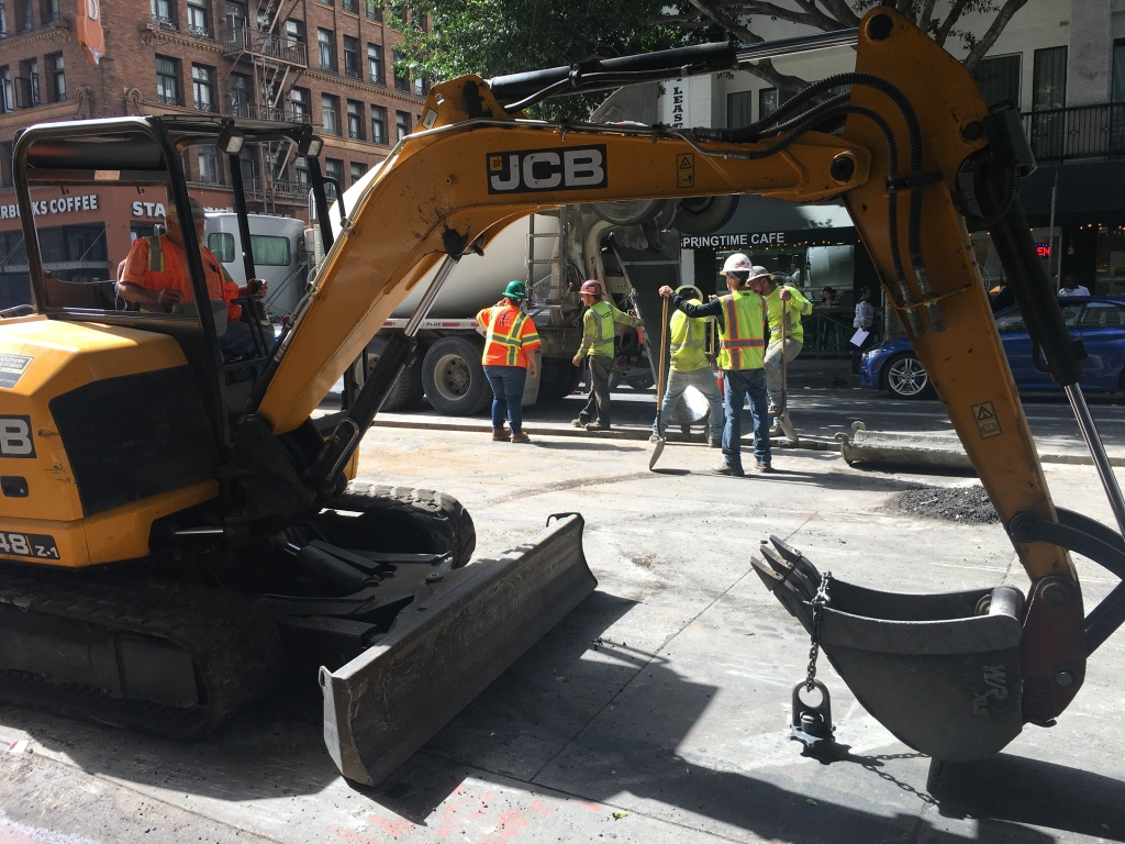 Construction crews work with heavy equipment near Sixth and Spring streets in Downtown L.A.