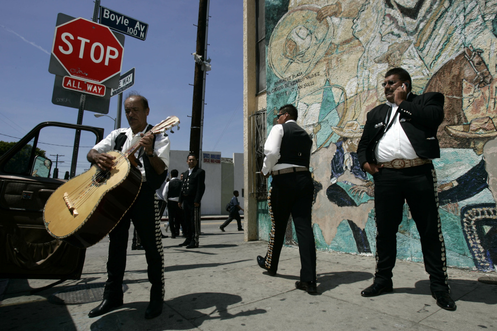 In this file photo, mariachis wait for work on Cinco de Mayo, at Mariachi Plaza in Los Angeles.