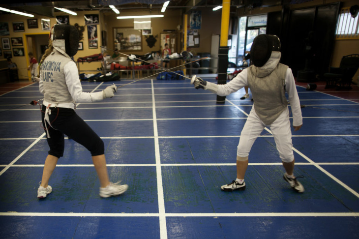 Gerard Moreno lunges at his fencing partner and fellow Paralympian, Mario Rodriguez on August 20 at the Los Angeles International Fencing Center in West Los Angeles.