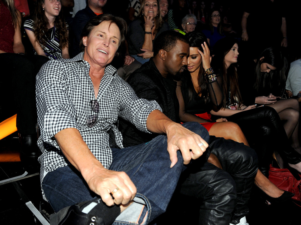From left, Bruce Jenner, Kanye West and Kim Kardashian attend FOX's