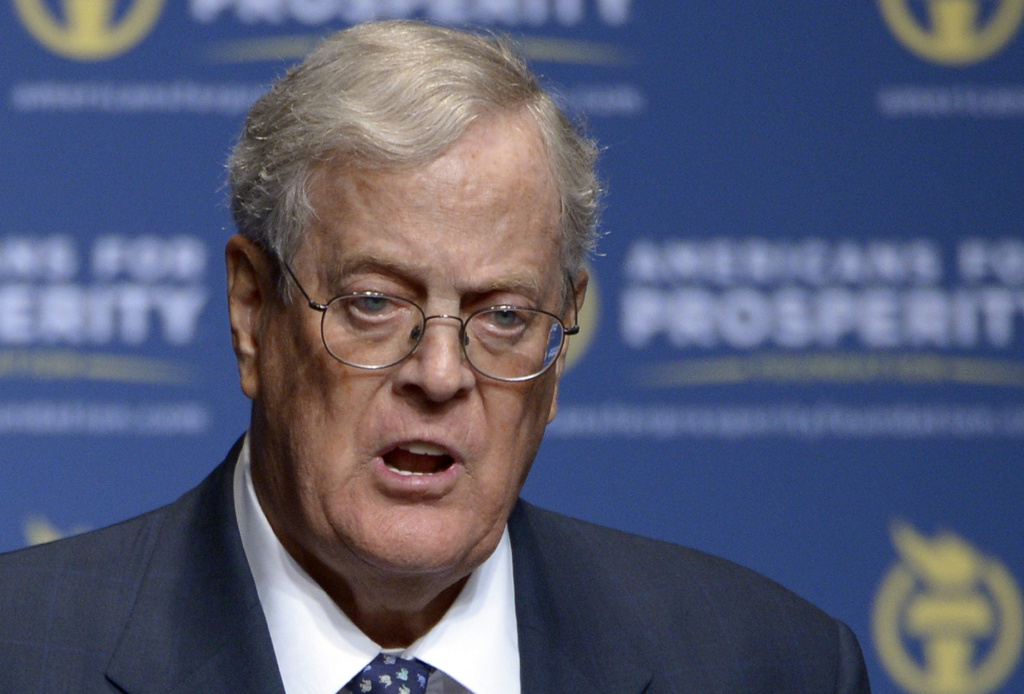 In this Aug. 30, 2013 file photo, Americans for Prosperity Foundation Chairman David Koch  speaks in Orlando, Fla. The billionaire conservative Koch brothers benefited from the health care law they abhor by letting