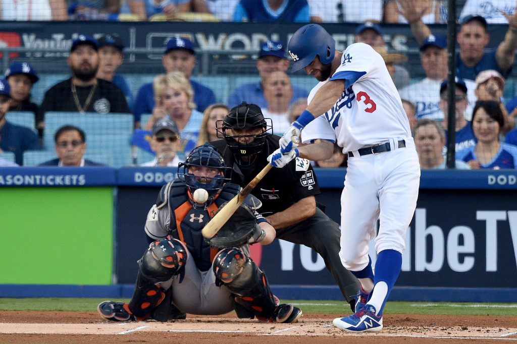 Los Angeles Dodgers' Chris Taylor hits a solo home run during the first inning against the Houston Astros in game one of the 2017 World Series at Dodger Stadium on Oct. 24, 2017.