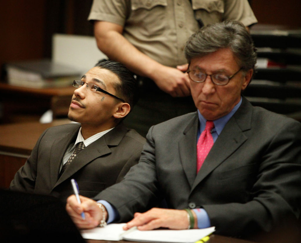 Pedro Espinoza (L) reacts after the jury announced their verdict on May 9, 2012 in Los Angeles, California. Espinoza was found guilty of first-degree murder for the fatal shooting of high-school football player Jamiel Shaw Jr., in 2008, before a death sentence was recommended by a jury in the penalty phase.