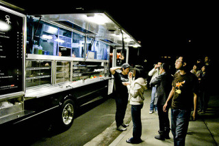 The Komodo Truck, serving a variety of burritos, salads and rolls, is one of the participants at the street food fest.