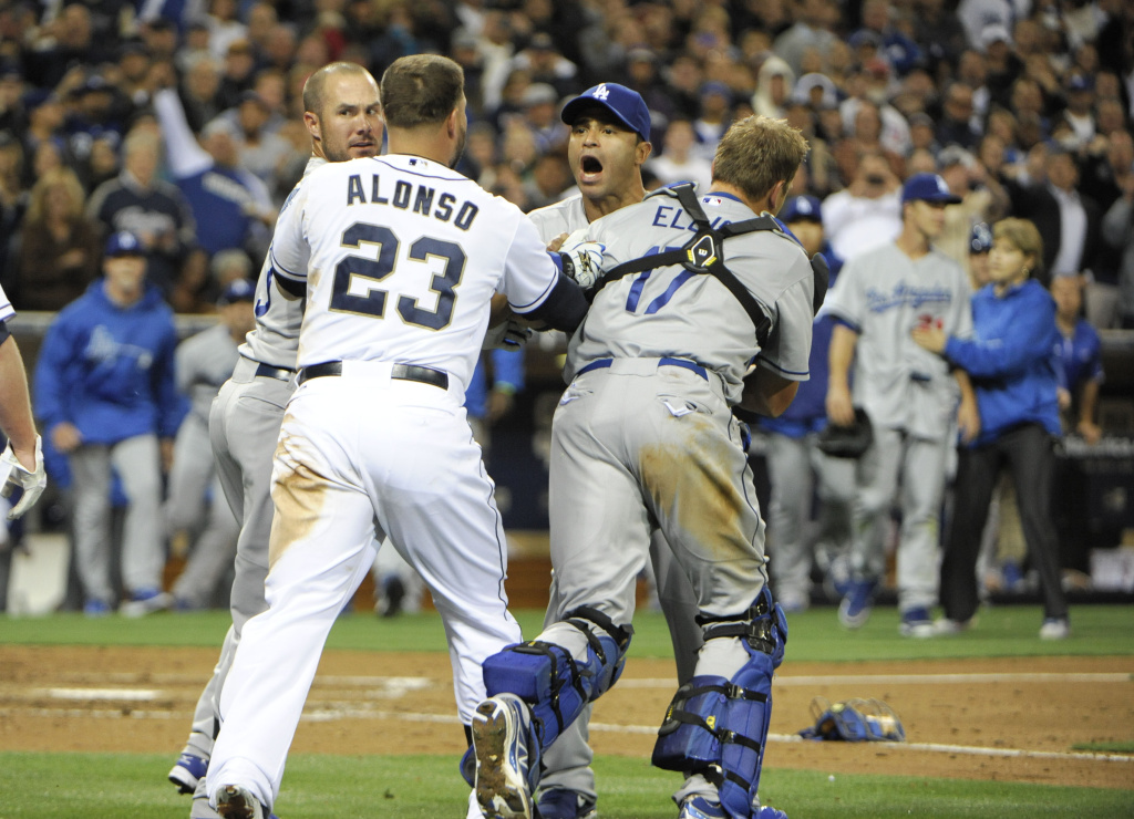 San Diego Padres players and Los Angeles Dodgers players brawl after Carlos Quentin #18 charged Zack Greinke #21 of the Los Angeles Dodgers after being hit with a pitch during the sixth inning at Petco Park on April 11, 2013 in San Diego, California.