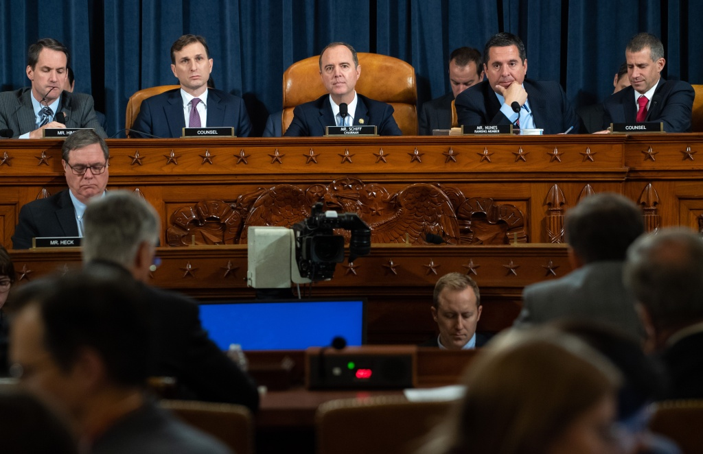 Chairman Adam Schiff (C), Democrat of California, and Ranking Member Devin Nunes (2nd R), Republican of California, during the first public hearings held by the House Permanent Select Committee on Intelligence as part of the impeachment inquiry into US President Donald Trump, with witnesses Ukrainian Ambassador William Taylor and Deputy Assistant Secretary George Kent testifying, on Capitol Hill in Washington, DC, November 13, 2019. - Donald Trump faces the most perilous challenge of his three-year presidency as public hearings convened as part of the impeachment probe against him open under the glare of television cameras on Wednesday. (Photo by SAUL LOEB / POOL / AFP) (Photo by SAUL LOEB/POOL/AFP via Getty Images)