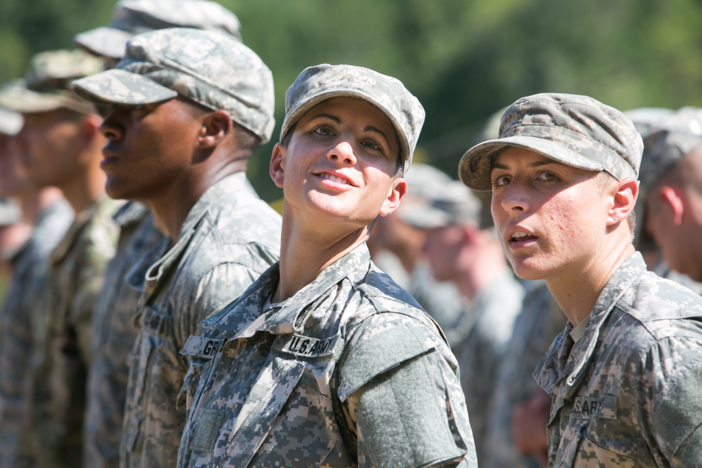 Capt. Kristen Griest (left) and 1st Lt.  Shaye Haver look on during the graduation ceremony of the United States Army's Ranger School on August 21, 2015 at Fort Benning, Georgia . Their success has prompted questions about excluding women from combat--and the Selective Service.