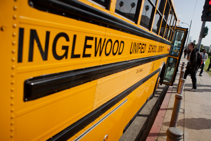 A student boards a bus maintained by the Inglewood Unified School District on February 28, 2012.