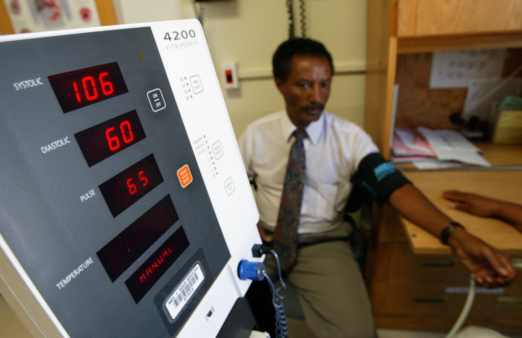 A man has his blood pressure checked July 9, 2003 at Highland Hospital in Oakland, California.