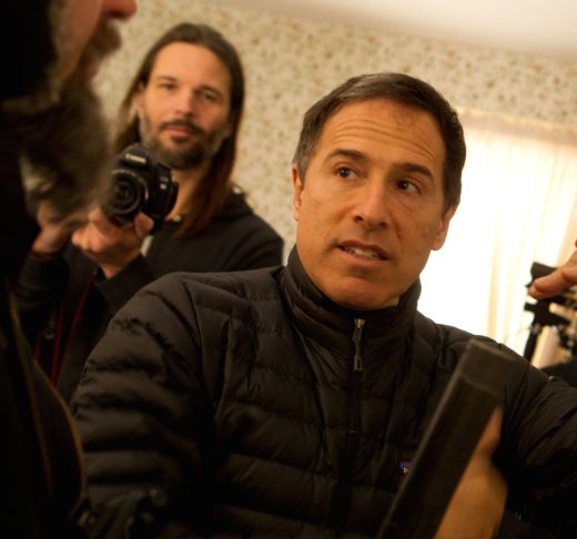 Writer-director David O. Russell with actress Jennifer Lawrence on the set of
