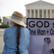 An anti same-sex marriage demonstrator stands in front of the US Supreme Court in Washington, DC, June 18, 2015, awaiting the court's landmark decision.   AFP PHOTO/JIM WATSON        (Photo credit should read JIM WATSON/AFP/Getty Images)
