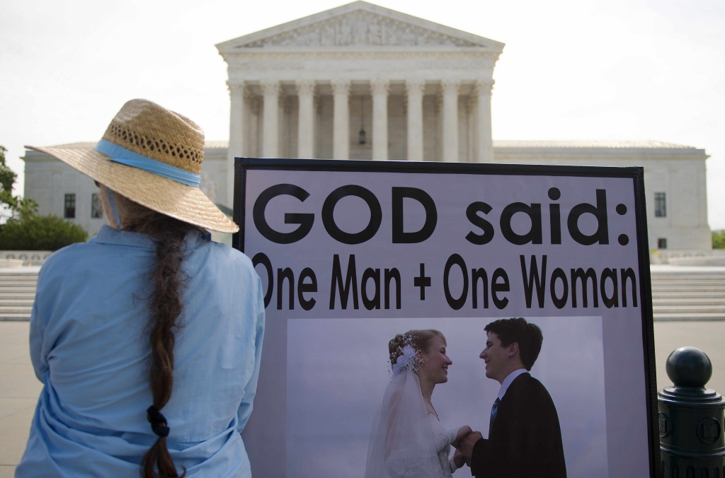An anti same-sex marriage demonstrator stands in front of the US Supreme Court in Washington, DC, June 18, 2015, awaiting the court's landmark decision.