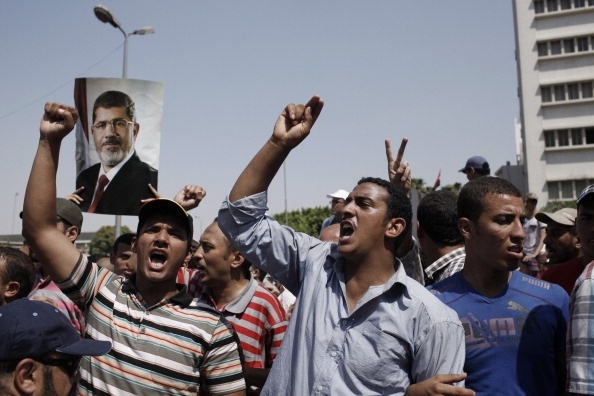CAIRO, EGYPT - JULY 5: Supporters of former Egyptian President Mohammed Morsi demonstrate in front of the headquarters of the Egyptian Republican Guard in Nasr City in Cairo, Egypt.  (Photo by Ed Giles/Getty Images).